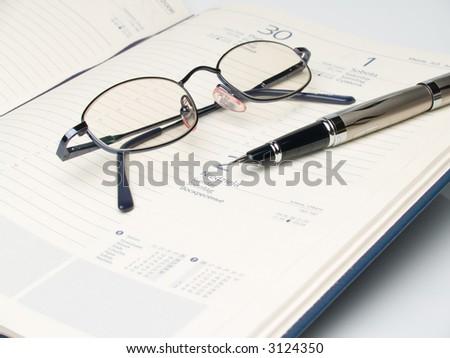 qlasses, calendars and the pen