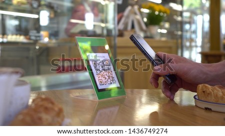 QR code pay. To use a QR code payment the consumers scans the QR code displayed by the merchant with their phones to pay for their goods.They enter the amount they have to pay and finally submit