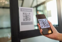 Qr code payment. E wallet. Man scanning tag accepted generate digital pay without money.scanning QR code online shopping cashless technology concept