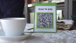 QR Code Payment. Mobile Payments For Restaurants using QR code scanning app. Touchless digital payment option for businesses