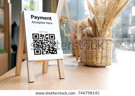 Qr code payment , online shopping , cashless society technology concept. Coffee shop accepted digital pay without money , wooden tag on table. #744798145