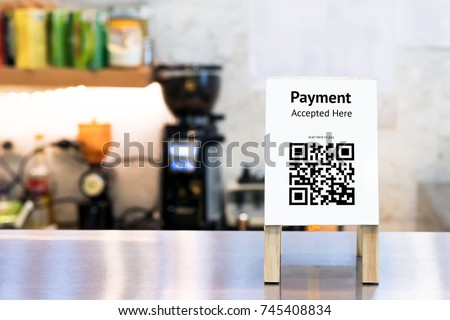 Qr code payment , online shopping , cashless society technology concept. Coffee shop accepted digital pay without money , wood stand tag on table. #745408834