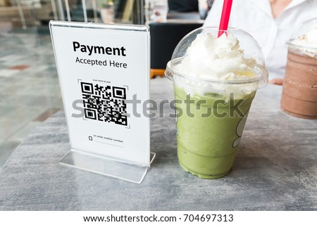 Qr code payment , online shopping , cashless technology concept. Coffee shop accepted digital pay without money , plastic tag on table. #704697313