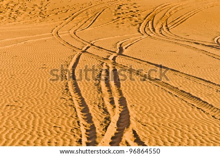 Quad and motorcycles tracks on Erg Chebbi at Morocco - stock photo