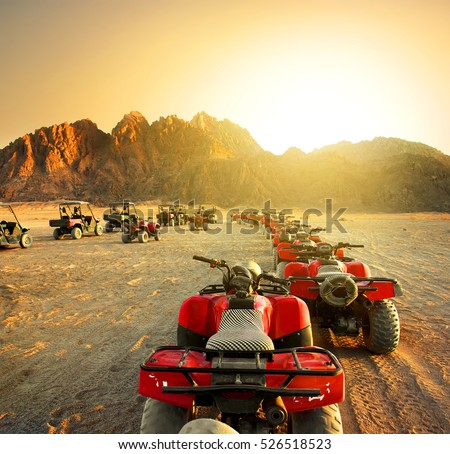 Quad bikes in desert at the sunset Stock photo ©