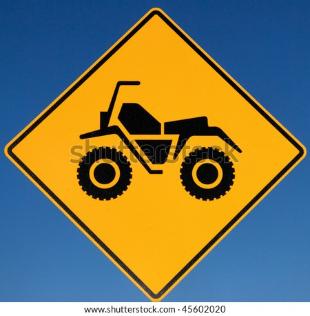 Quad Crossing road sign