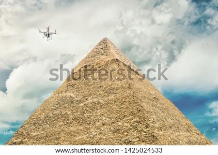 Quadcopter rises into the air to make a movie pyramid . The Pyramid of Khafre or Chephren . Second largest of the Egyptian Pyramids of Giza