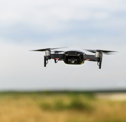 Quadcopter with digital camera in flight. Drone in the film industry. Broadcast and record with a digital quadcopter camera.