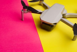 Quadrocopter on the background . Drone. Drone on a pink background. An article about modern technologies. Modern cameras. Shooting from the air. Article about choosing a quadrocopter.  Copy space