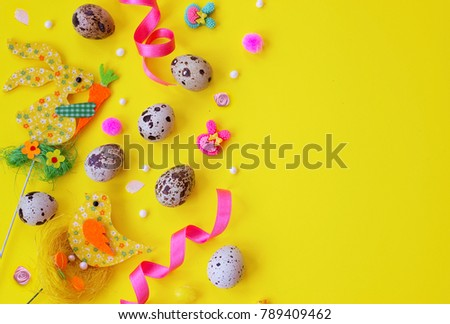 Quail eggs and easter decoration on yellow background with copy space; easter background #789409462