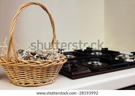 quail eggs in the basket at the gas stove