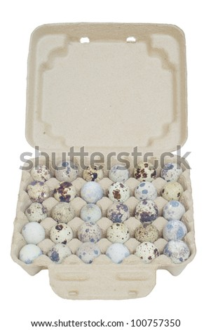 Quail eggs in the package isolated on white background