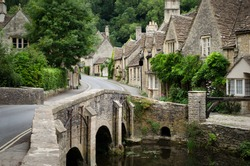 Quaint Castle Combe village with its characteristic bridge in the Cotswolds, UK. Rural England at its best.