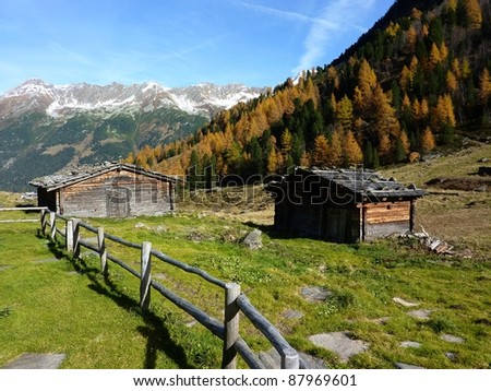 Quaint cottages in the autumn Alps - stock photo