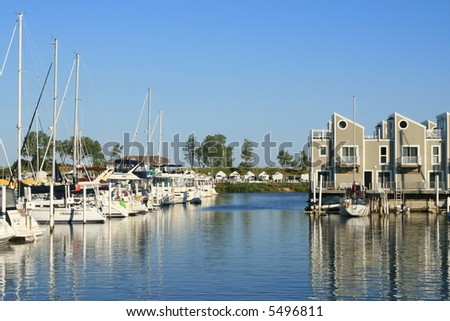 Quaint Harbor in Michigan in the summer, on Lake Michigan - stock photo