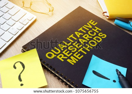 Qualitative research methods and sticks on a desk.