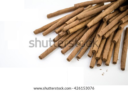 Quality cigars and tobacco leaves on white background