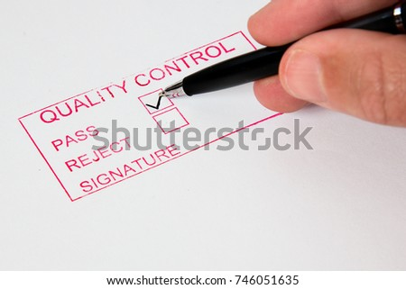 Quality Control   A quality control stamp with pass or reject.