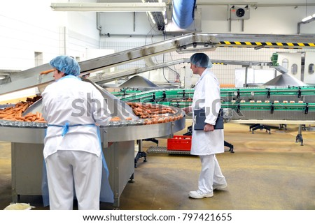 quality control in a meat processing plant - production of sausages in a factory  #797421655