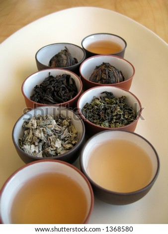 Quality dried Chinese tea leaves with freshly brewed drinks.