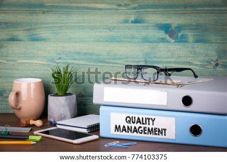 quality management concept. Binders on desk in the office. Business background
