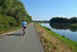 Quality new asphalt cycle paths. Labe River in the Czech Republic. Cycling concept, cyclist rides a bicycle.
