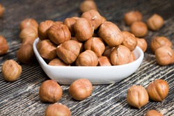 quality raw nuts hazelnuts ready to eat, hazelnut on the kitchen table during cooking, hazelnuts fresh and peeled, the surface of the nuts is not perfect and has some natural defects due to their