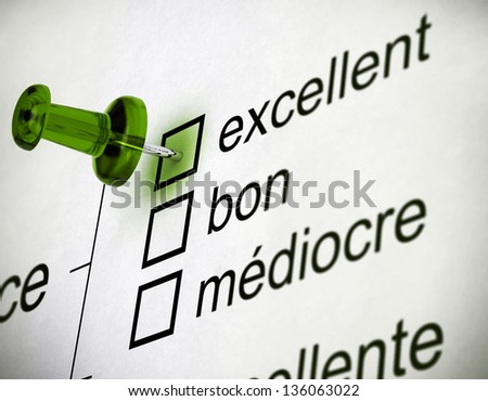Quality survey close up with a thumbtack pointing on the word excellent