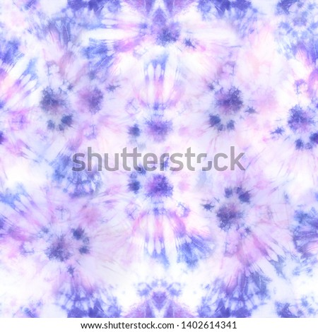 Quality tie dye repeat pattern in muted hues of pink and purple. Seamless pattern.