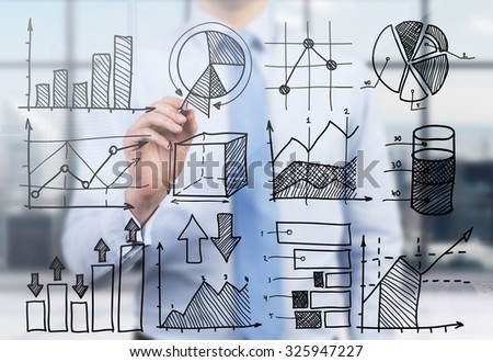 Quantitative analyst is drawing different charts on the glass screen. A concept of professional financial consulting services.