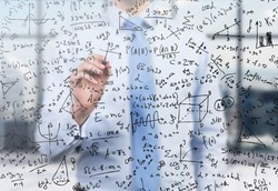 Quantitative analyst is drawing different math formulas on the glass screen. A concept of professional financial consulting services.