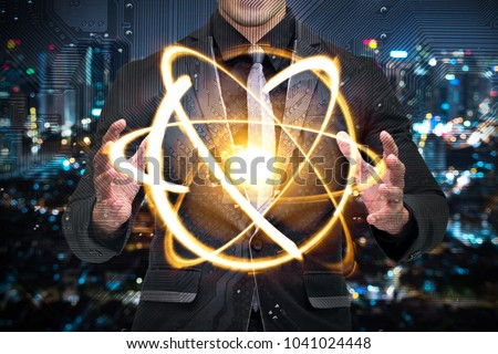 Quantum computer technology concept. Man in suit holding science yellow shining cosmic atom nuclear.