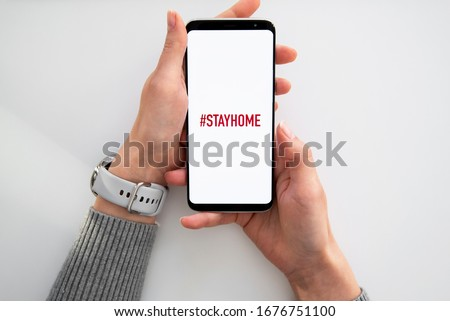Quarantine and warning, attention, outbreak alert notification on mobile and smart watches devices. Stay at home advice to stop coronavirus COVID-19 spreading. Global pandemic Covid -19 prevention