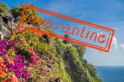 Quarantine due to coronavirus epidemic covid19 Pura Luhur Uluwatu temple, Bali, Indonesia. Amazing landscape - cliff with blue sky and sea