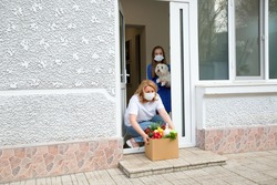 Quarantine or self isolated family receiving food to door