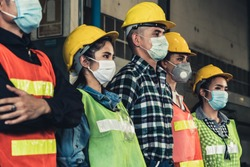 Quarantined masked workers protect spreading of Covid 19 by wearing face masks. Coronavirus Disease or COVID can spread easily without mask. Workers are advised to wear masks during quarantine time.