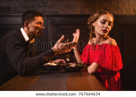 Quarrel of couple in restaurant, bad relationship