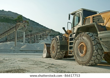 Quarry and Bulldozer. Vertical image