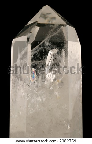 Quartz Crystal. Healing powers in alternative health. Light passes through this strongly bound intricacy structure. Fluid inclusions, trigonal symmetry & crystal faces well developed.  Tectosilicate.