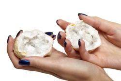 Quartz geode in female hands isolated on white background. Nails with blue manicure.