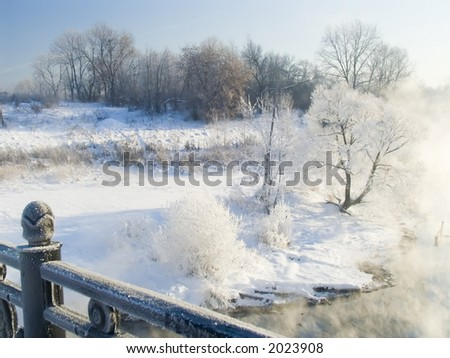 Quay of the river in frosty day