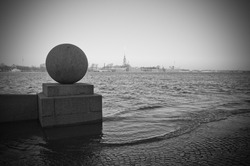 Quay of the river Neva in the historical center of St.-Petersburg during flooding. Monochrome.