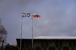 Quebec and Montreal flags flying in the wind