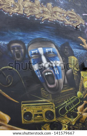 QUEBEC, CANADA-May 5: is year of municipal election in Quebec city. Beautiful graffiti in Quebec city, with young man screaming with quebecian flag maked up in his face on May 5, 2013 in Quebec.