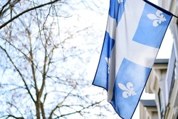 Quebec flag in Montreal billowing in the breeze outside