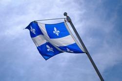 Quebec Flag pole on blue sky national st-jean banner