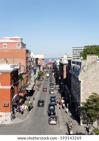 QUEBEC � SEPTEMBER 24: Shoppers and cars move up and down Rue Saint-Jean in Quebec City, Quebec on September 24, 2011. Quebec City is the capitol of the Canadian province of Quebec.