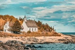 Quebec travel destination in Baie St-Paul, Charlevoix. Canada scenery landscape of autumn. Church by the sea.