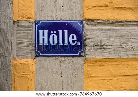 QUEDLINBURG, GERMANY – August 16, 2017: Street sign of Holle (Hell), Quedlinburg, Saxony-Anhalt, Germany. #764967670