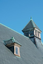 Queen Ann style roof with gable-roofed dormer Medfield MA USA